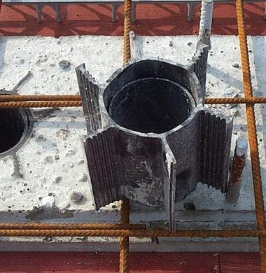 Krimpkokers maken betongevel zonder dilatatievoeg mogelijk